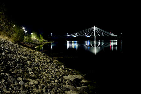 cable bridge: Cable Bridge in Umea, Sweden at night with reflections in the water. Stock Photo
