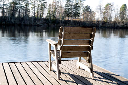 lawn chair: Wooden Chair By River Stock Photo