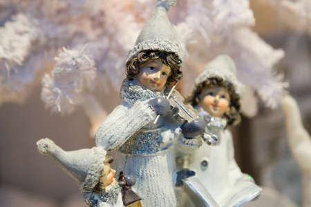 figurines: Christmas Figurines Playing Violin Stock Photo