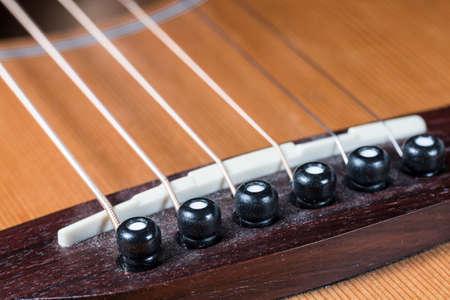saddle: Guitar Saddle and Bridge Stock Photo