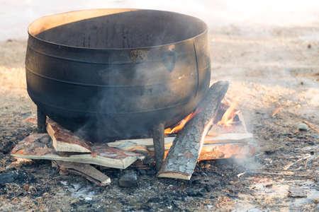 fire pit: Black kettle on fire pit