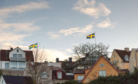 sweden flag: Swedish Flags in Visby, Gotland in Sweden Stock Photo
