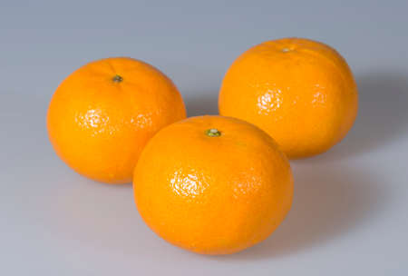 clementines: Three Clementines Close Up Stock Photo