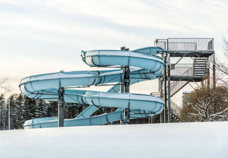 water   slide: Water Slide in Winter with Snow and a cloudy sky Stock Photo