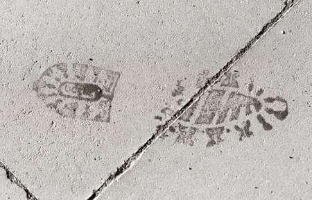 imprint: Footstep Imprint on Pavement Stock Photo