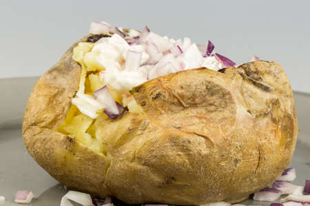 Baked Potato with Red Onion close up on plate