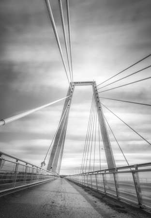 cable bridge: Cable Bridge in Umea, Sweden with a partly cloudy sky