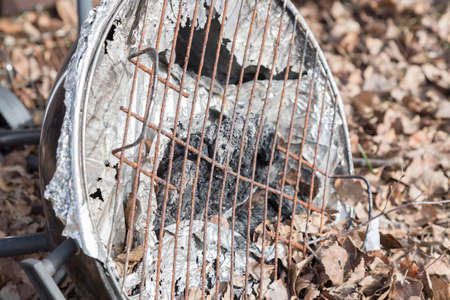 bad condition: Barbecue in Bad Condition lying on the ground with leaves.