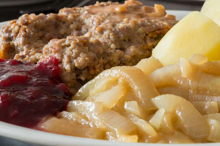 meatloaf: Meatloaf with Potatoes, Caramelised Onions and lingonberry jam. Stock Photo