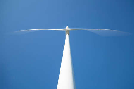 kinetic energy: Wind Power Station from Below with a clear blue sky behind it.