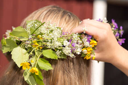 midsummer: Swedish Midsummer Headgear Traditional on a female head of hair. Stock Photo