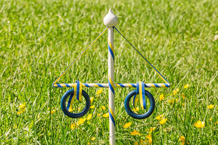 maypole: Ornament Maypole in Grass with buttercup flowers.