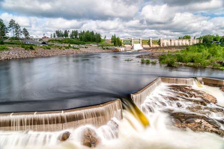 hydropower: Hydropower Plant in Stornorrfors, Sweden with a cloudy sky.