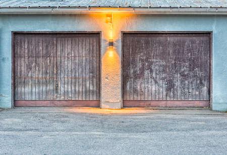 garage doors: Pair of Garage Doors with a light between them.