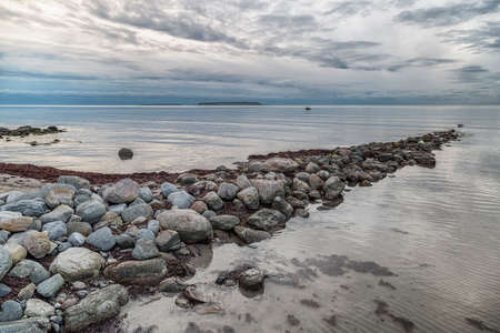 lilla: Ocean with Rocks and Clouds with Lilla and Stora Karlsö in the distance.