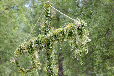 midsummer pole: Swedish Maypole Covered in Flowers. Stock Photo