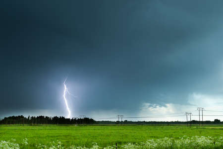 Lightning over Agricultural Field with a cloudy sky.