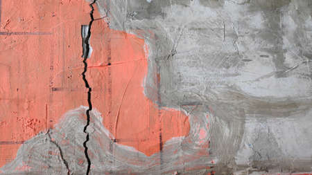 Gray cement concrete wall pattern with cracks on the surface as background