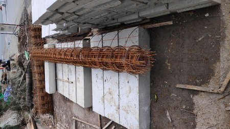 Stock Photo - The reinforcing bars are rusted around the construction site.