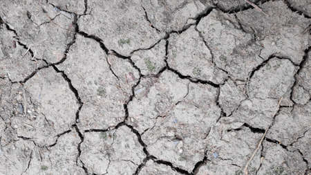 Stock Photo - Cracked textured dry ground surface as a background.