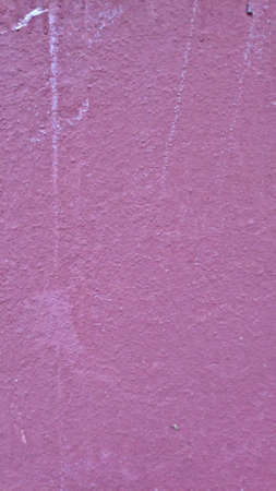Stock Photo - Old building with red and pink background on cement wall surface. Stockfoto