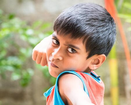 anger kid: Kid showing emotions of Anger, hate, disgust and distress Stock Photo