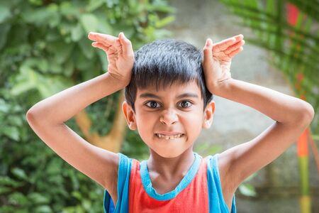 anger kid: Kid showing emotion of anger, surprise, rage, distress Stock Photo