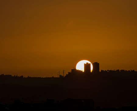A sunrise in a clear sky over Jerusalem, Israel