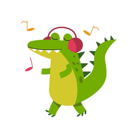 Carattere divertente del coccodrillo del fumetto in musica d'ascolto delle cuffie e illustrazione di camminata di vettore Archivio Fotografico - 80122880
