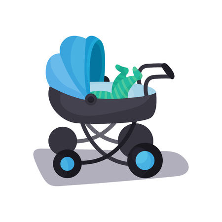 Little baby lying in a blue modern baby pram