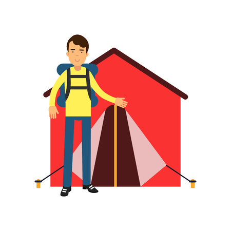 Smiling man tourist standing near red tent with backpack on his shoulders. Camping and outdoor recreation concept