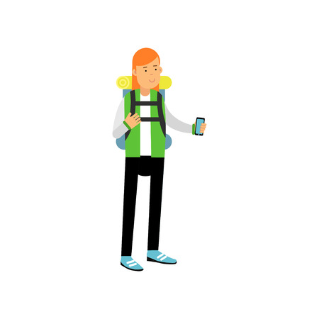 Red-haired girl in camping outfit with backpack on her shoulders standing and taking photo on smartphone. Camping or hiking design concept
