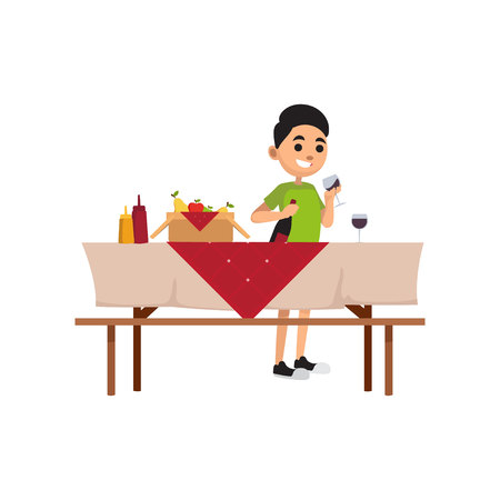 Young smiling boy spending time outdoors. Teenager stand near picnic table with food and fill glass with wine. Summer or spring activity. Vector cartoon flat character isolated on white background.