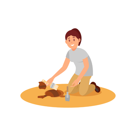 Young smiling woman sweeping dirt off ancient ceramic jug. Archaeologist working on excavation. Flat vector design