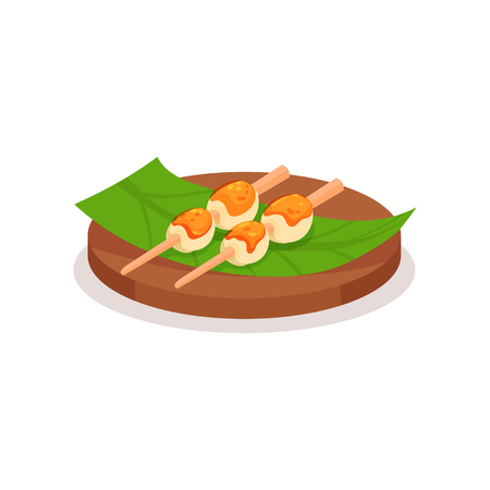 Icon of rice balls topped with sweet sauce on green leaf. Traditional Asian dessert on wooden sticks. Food theme. Graphic element for recipe book, promo flyer or cafe menu. Isolated flat vector design  イラスト・ベクター素材