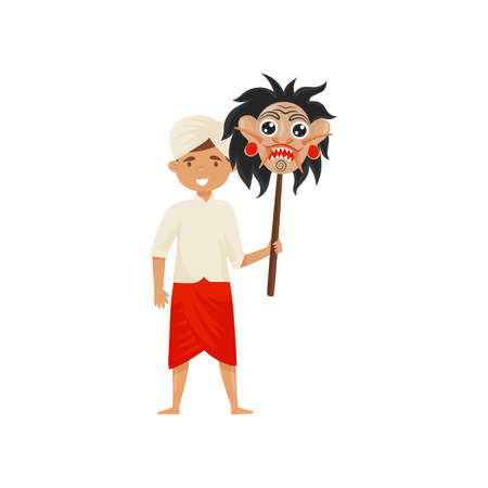 Young Balinese man holding mask of Rangda on wooden stick. Smiling guy dressed in traditional clothes. Cartoon male character. Colorful vector illustration in flat style isolated on white background. Ilustração