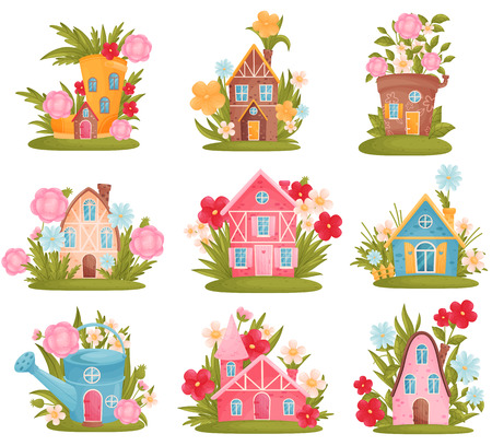 Set of fabulous houses among the flowers and grass. Vector illustration on white background. 向量圖像
