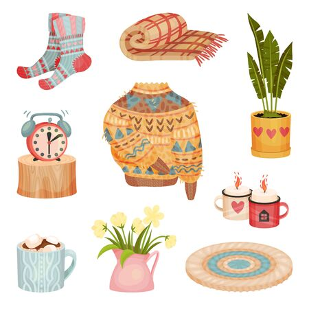 Set of cozy things. Sweater, plaid, socks, tea, candle. Vector illustration on a white background.