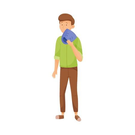 Young Sad Man Standing and Holding Mask with Happy Emotion in His Hands Vector Illustration