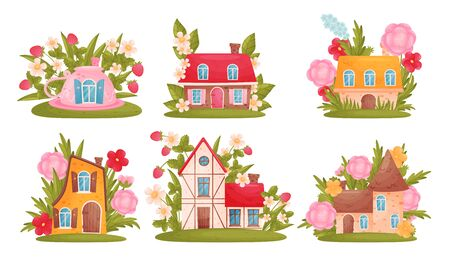 Fabulous Houses Surrounded by Grass and Flowers Vector Set. Fairy Buildings for Gnome Concept Vettoriali