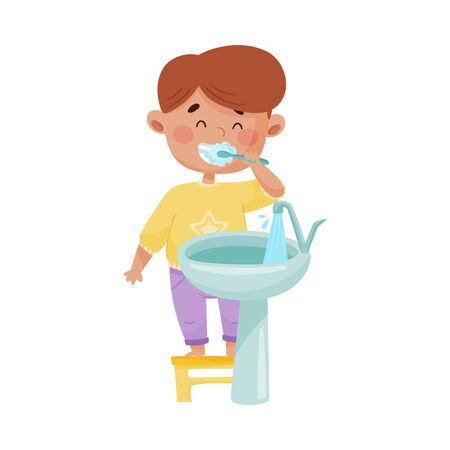 Little Boy Brushing His Teeth Standing on Stool in Front of the Sink Vector Illustration. Kid Engaged in Morning and Bath Procedures Concept Vetores