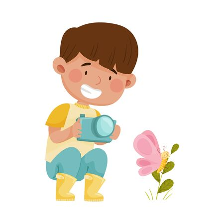 Little Boy Hunkering Down with Camera Taking Photo of Butterfly Sitting on Grass Vector Illustration Vecteurs