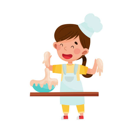 Little Girl Character in Hat and Apron Standing at Kitchen Table and Kneading Dough Vector Illustration. Little Kid Chef Engaged in Cooking Concept