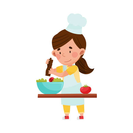 Cute Girl Character in Hat and Apron Standing at Kitchen Table and Dressing Salad  Illustration. Little Kid Chef Engaged in Cooking Concept