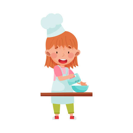 Cute Girl Character in Hat and Apron Standing at Kitchen Table and Mixing Pastry Illustration. Little Kid Chef Engaged in Cooking Concept