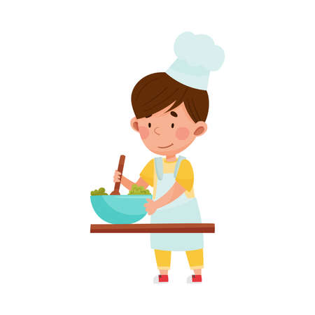 Cute Boy Character in Hat and Apron Standing at Kitchen Table and Stirring Salad  Illustration. Little Kid Chef Engaged in Cooking Concept