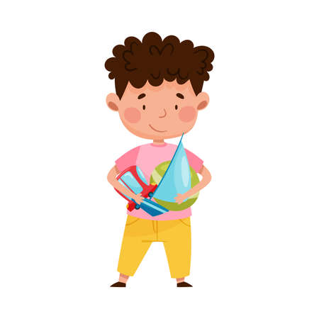 Red Cheeked Boy Holding Pile of Different Toys in Playroom Vector Illustration Vetores