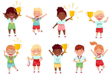 Cute Little Boy and Girl with Gold Medal and Cup as Achievement Award Vector Set Vettoriali