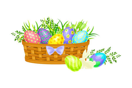 Painted or Foiled Easter Eggs or Paschal Eggs Rested in Wicker Basket in Green Grass Vector Illustration