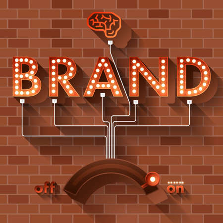 Text BRAND with ball light on background brick.